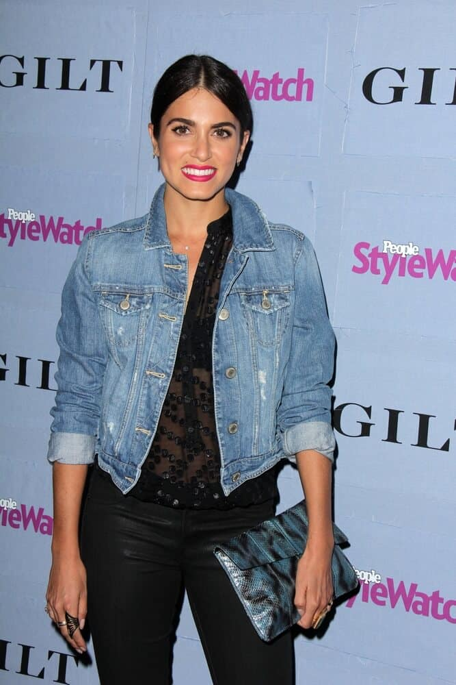 Nikki Reed matched her denim jacket with a straight, low ponytail during the People Stylewatch Hollywood Denim Party at Palihouse on September 19, 2013.