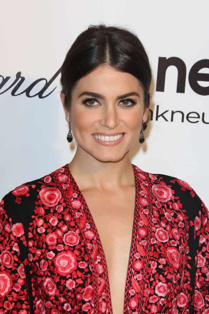 Nikki Reed proved that simplicity is beauty with her center-parted, low ponytail that she wore during the Elton John AIDS Foundation Presents 22nd Academy Awards Viewing Party, March 2, 2014.
