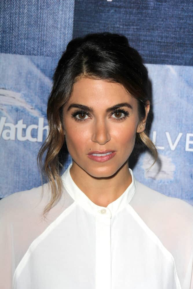 Last September 18, 2014 ,Nikki Reed attended the  People Stylewatch Hosts Hollywood Denim Party with her casual hairstyle, a simple but presentable bun with hair tendrils.