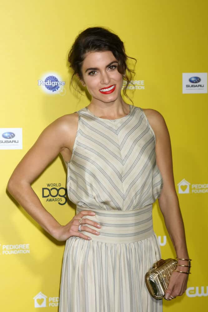 During the World Dog Awards 2015, Nikki Reed caught everyone's attention with her messy upstyle paired with a bold, red lipstick.