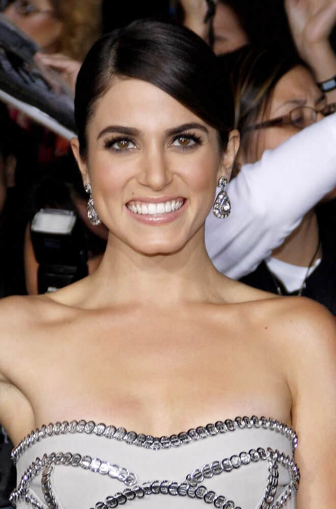 Nikki Reed kept it simple and elegant with this sleek updo as she arrived at the premiere of