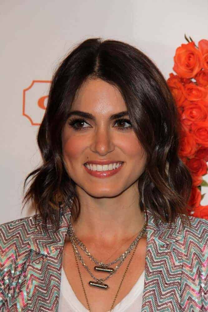 Nikki Reed exhibited a confident and charming personality with her tousled bob as she attended the Coach's 3rd Annual Evening of Cocktails and Shopping, April 10, 2013 in Santa Monica, CA.