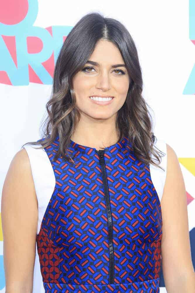 Nikki Reed looking so fresh and confident during the 5th Annual TeenNick HALO Awards as she wore her vibrant dress with a simple, long and wavy bob.