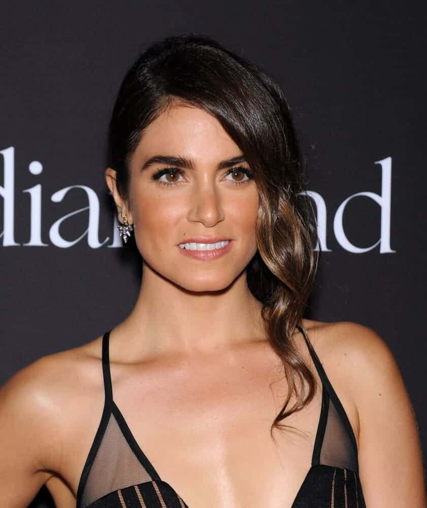 Nikki Reed's hair tendrils are absolutely iconic! This is the sophisticated look she wore at Rihanna's First Annual Diamond Ball, December 11, 2014.