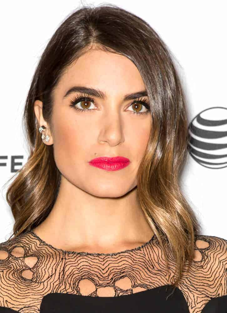 Nikki Reed's black dress went well with her sleek and shiny hairstyle during the premiere of 'Murder of a Cat' at the 2014 Tribeca Film Festival.