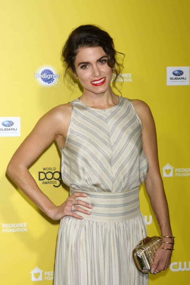 During the World Dog Awards 2015, Nikki Reed caught everyone's attention with her messy upstyle paired with a bold, red lipstick. Simple yet stunning!