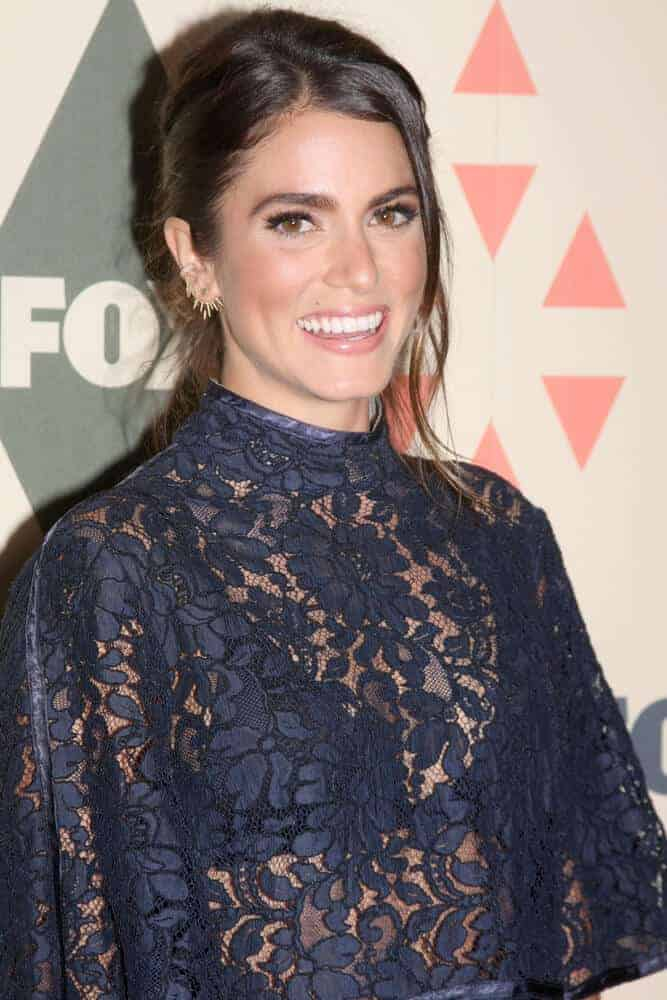 Nikki Reed in a messy bun with tendrils portrayed the clash of elegance and edginess. This hairstyle is worn at the FOX Summer TCA All-Star Party 2015 at the Soho House last August 6, 2015.