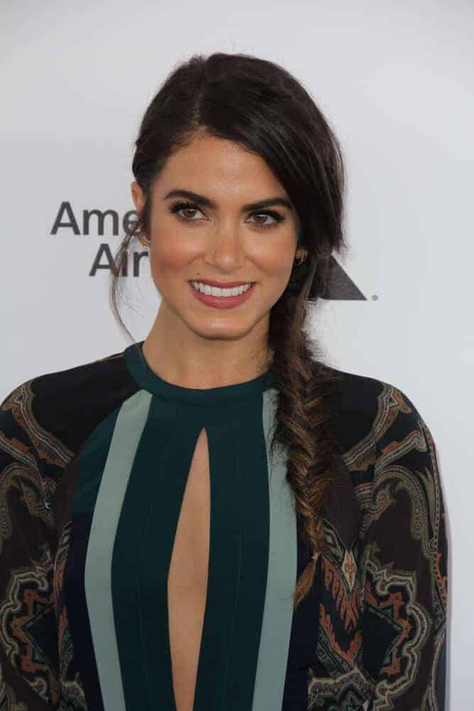 Nikki Reed oozing with charm and grace during the 2016 Film Independent Spirit Awards. She sported a side-swept fishtail braid with a slightly messy finish.