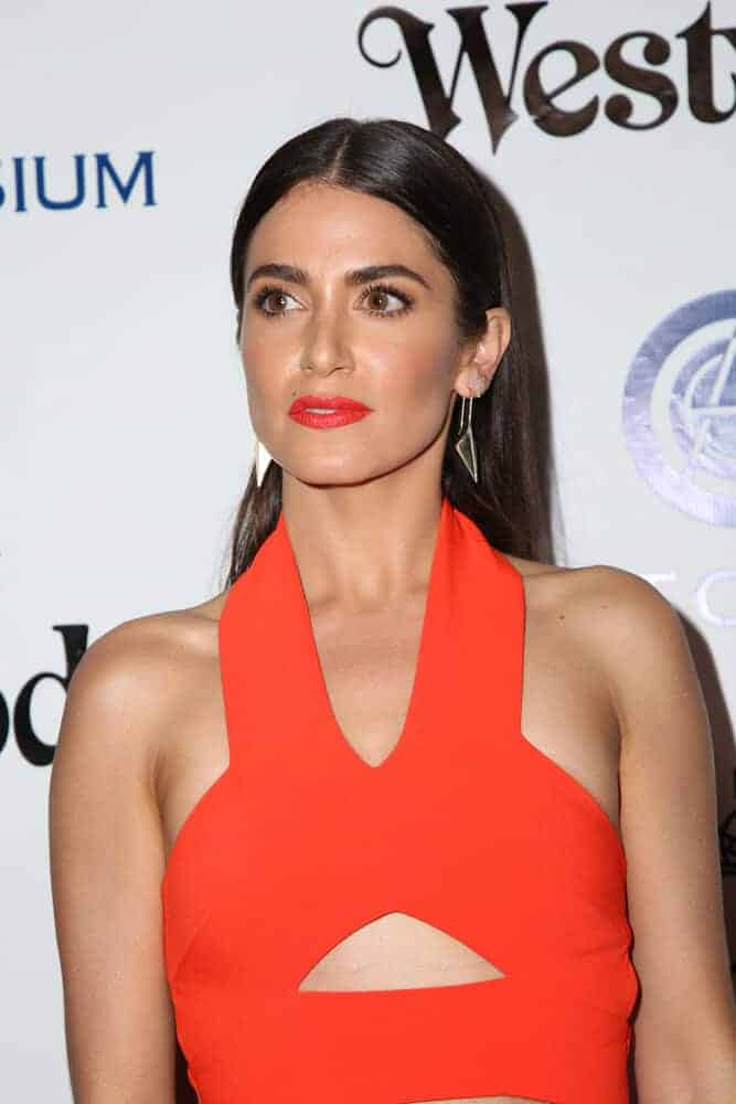 Last January 9, 2016, Nikki Reed overflowed with elegance and confidence during The Art of Elysium Ninth Annual Heaven Gala with her sleek and straight, center-parted hairstyle.
