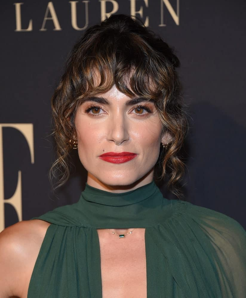 The actress slayed the ELLE Women in Hollywood on October 14, 2019, with a classic updo incorporated with eye-skimming bangs and curly tendrils on the sides.