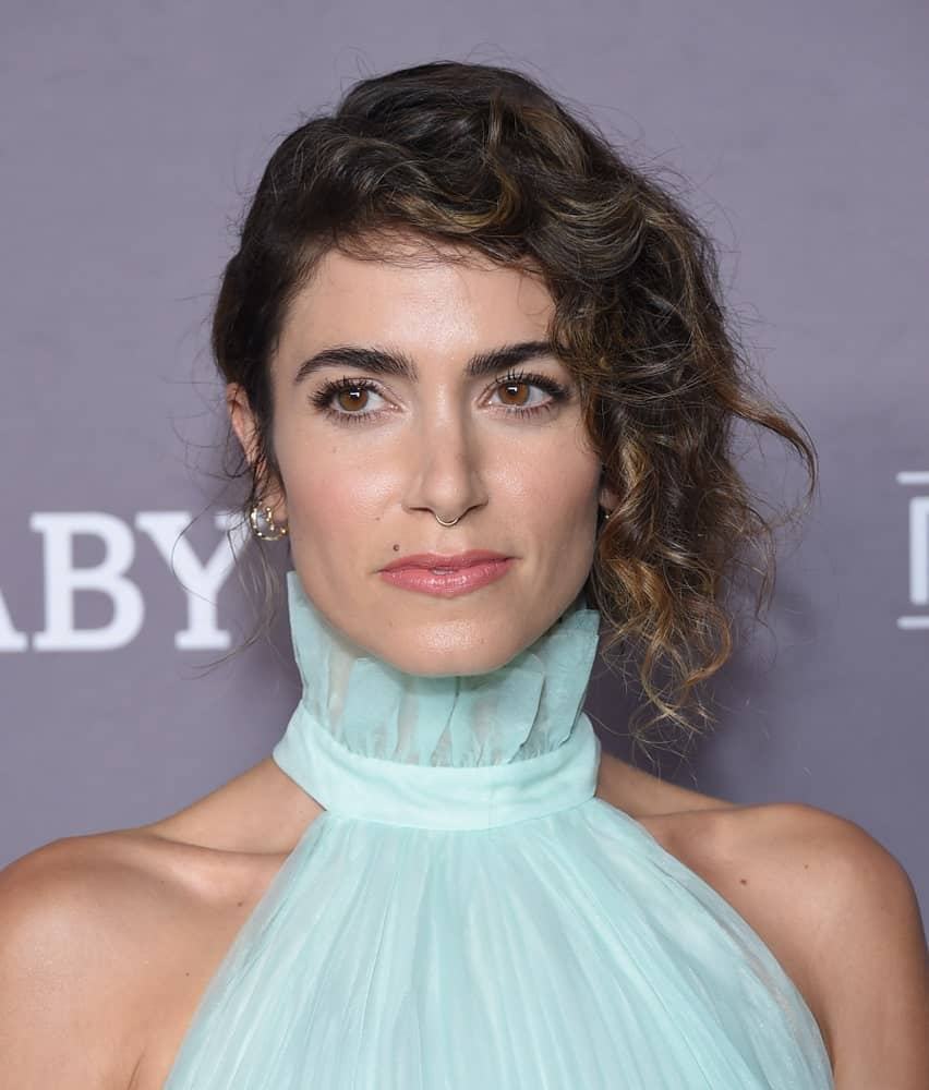 Nikki Reed looking all classy and posh in a pleated halter dress paired with a side-swept updo hairstyle. This look was worn during the 2019 Baby2Baby Gala Presented by Paul Mitchell last November 9th.