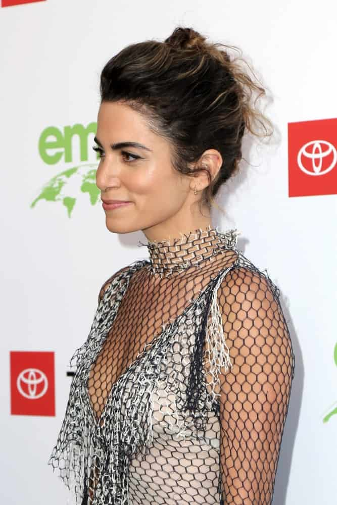 The model sported a long-sleeve netted dress along with a braided updo hairstyle that she wore during the 29th Annual Environmental Media Awards at the Montage Hotel on May 30, 2019.