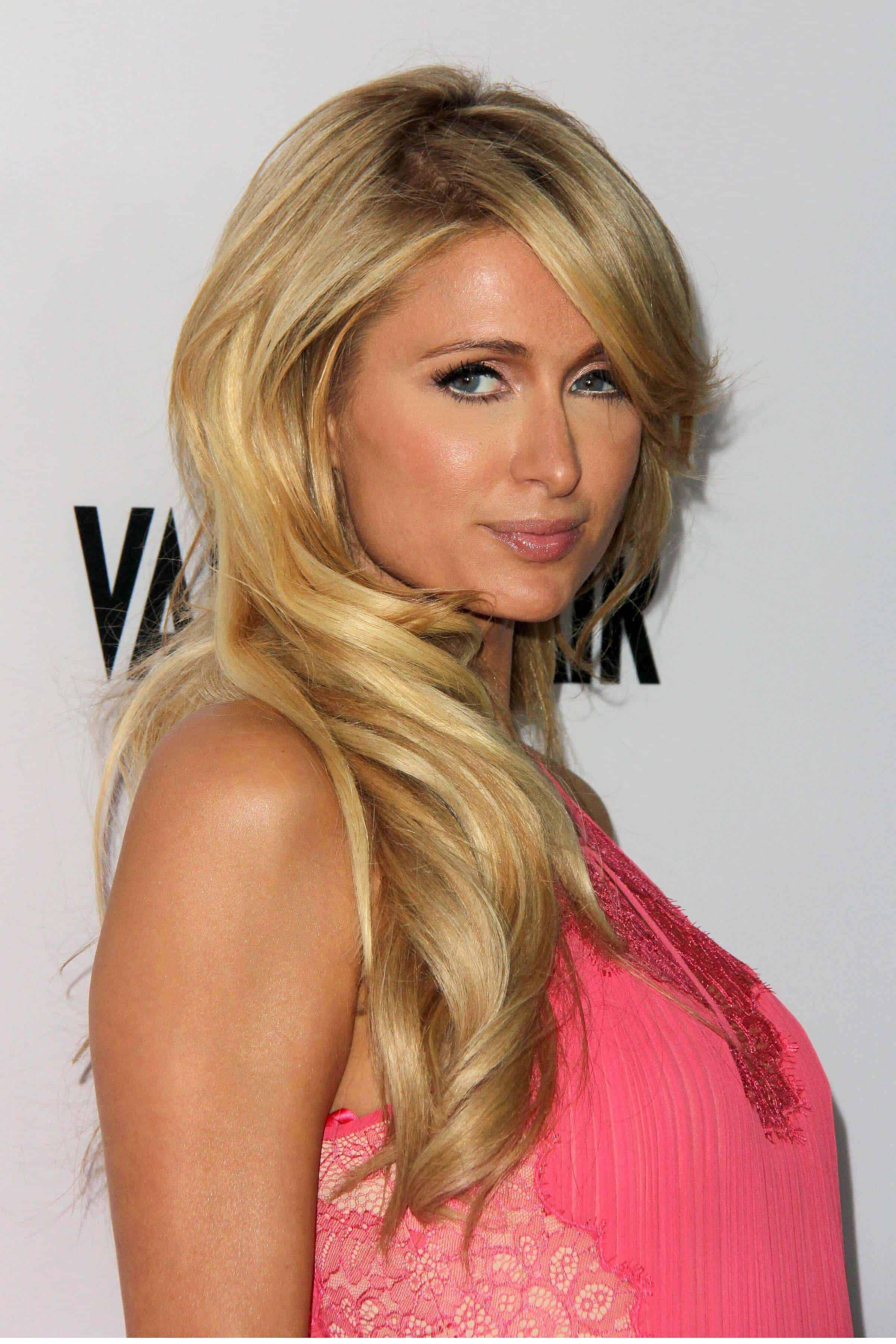 Paris Hilton looking casual yet stylish with her side-swept, layered hairdo during the