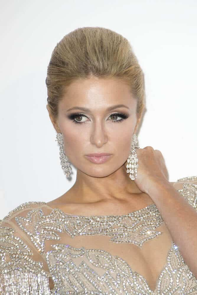 Paris Hilton attended the mfAR Gala Cannes 2017 in an elegant dress and a sleek, high-fashion updo.