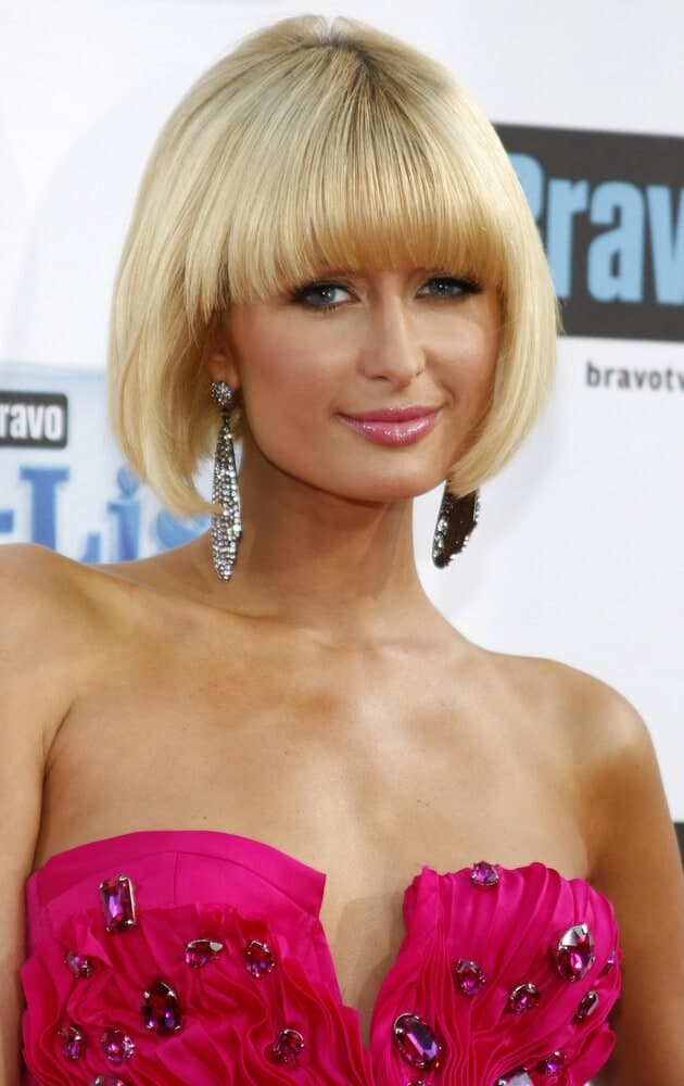 Paris Hilton slayed the 2009 Bravo's A-List Awards with a nicely-done bob cut and blunt bangs. She finished the look with chandelier earrings and a pink dress inlaid with gem embellishments.