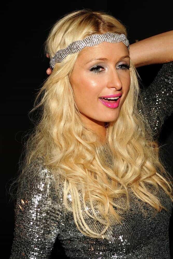 Paris Hilton rocks her loosely curled blonde hair with a silver head band during the Parish Hilton Sunglass Collection Launch Party, October 3, 2009.