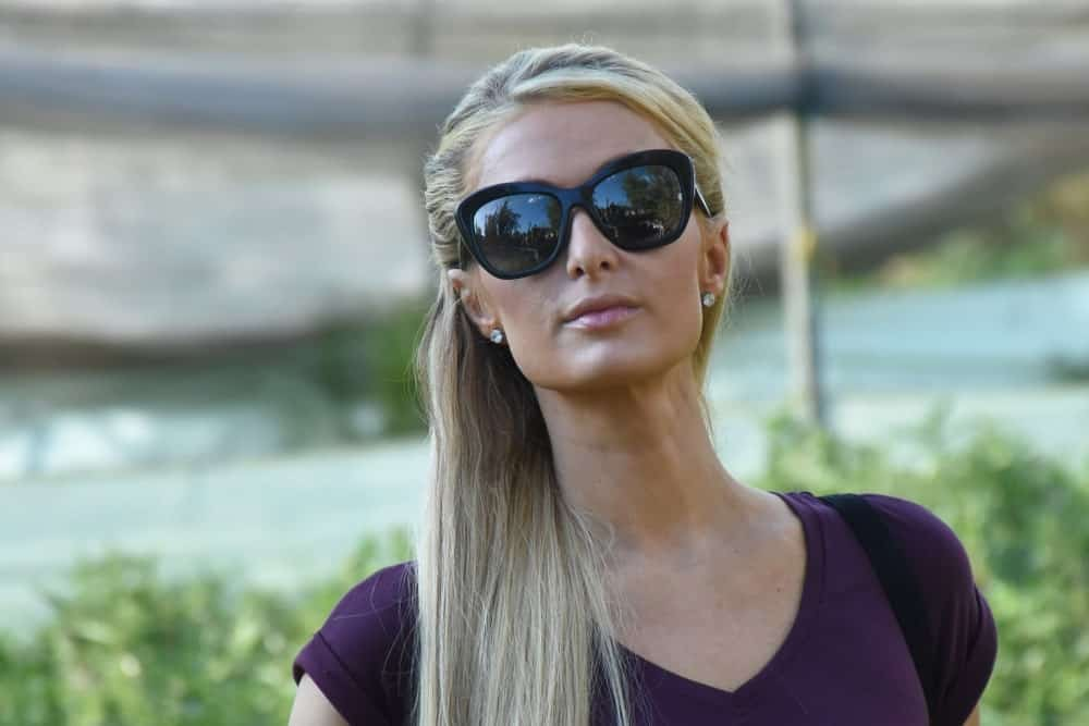 Paris Hilton was seen visiting the reconstruction of houses damaged by the 2017 earthquake on November 12, 2018 in Xochimilco, Mexico with a simple half updo hairstyle complemented with black shades and stud earrings.