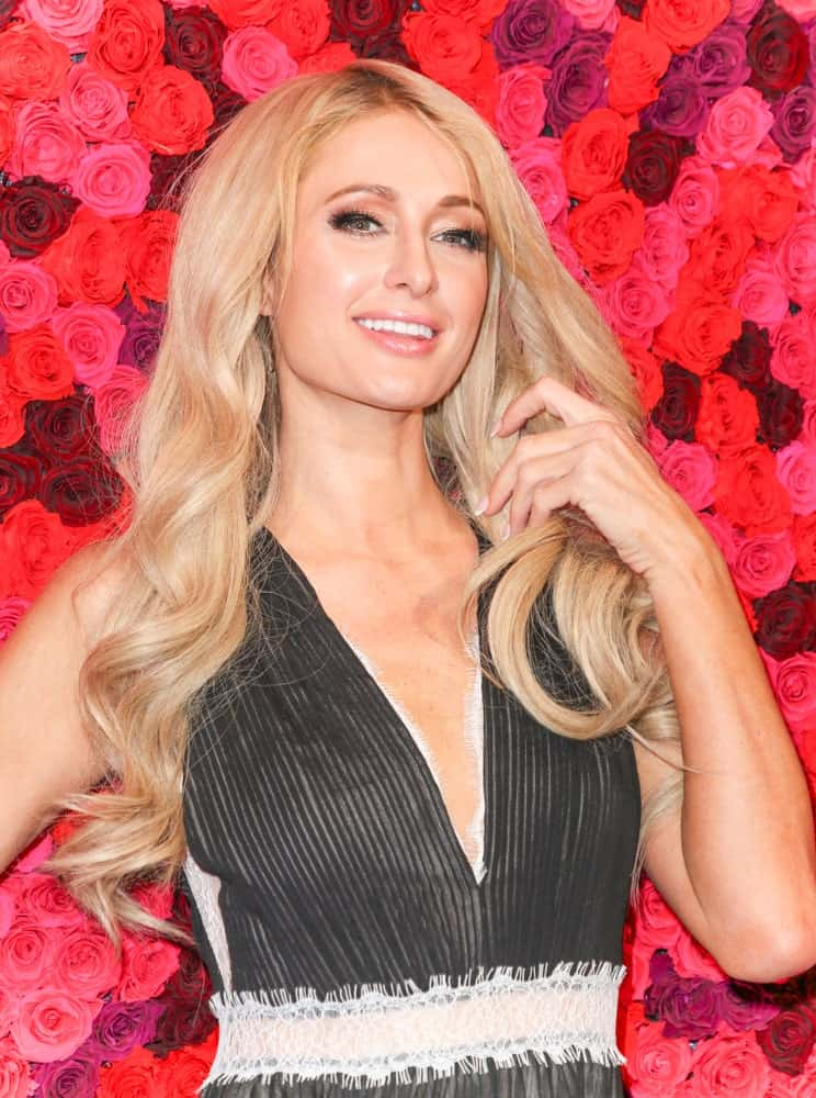 The Amerian socialite was spotted at the Alice + Olivia By Stacey Bendet presentation during New York Fashion Week on February 10, 2019 in a deep V-neck dress along with her long blonde waves.