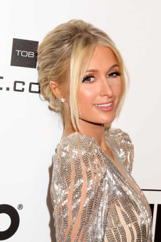 Paris Hilton looked ravishing at the Elton John Oscar Viewing Party on February 24, 2019 with her blonde tresses arranged into a glam updo. It is incorporated with long tendrils that are tousled a bit for a softer look.