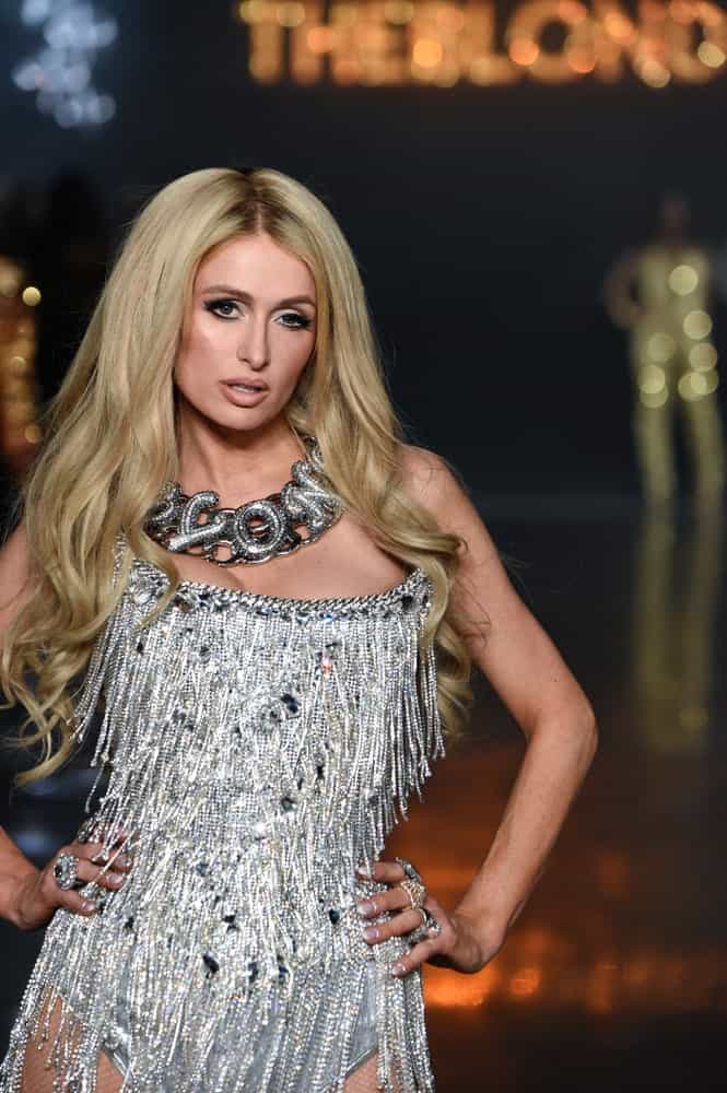 On February 12, 2019, Paris Hilton walked the runway for The Blonds during New York Fashion Week with her long voluminous blonde waves paired with a statement necklace.