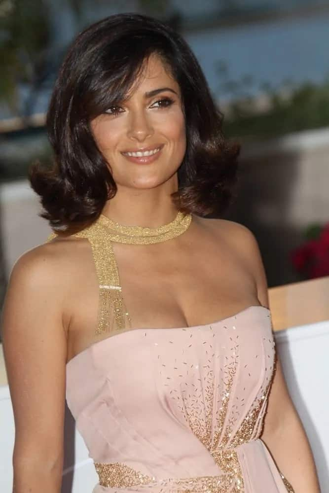 Salma Hayek opted for a vintage look for her bob hair with curls at the bottom for the Palme d'Or Award Ceremony Photo Call last May 23, 2010.