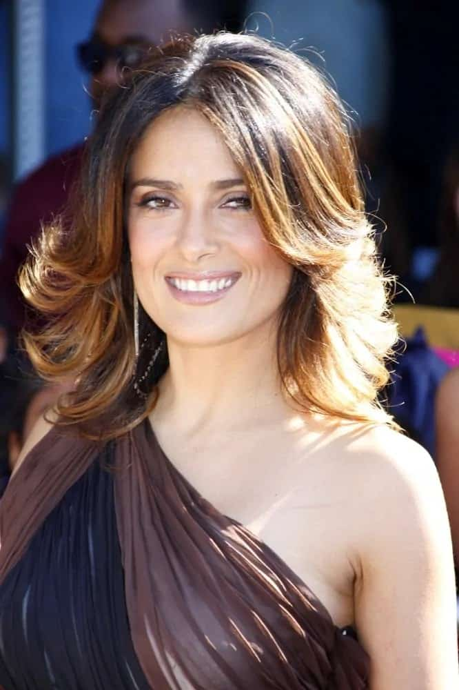 Salma Hayek flaunted her highlighted brunette layers in a feathered flip during the Los Angeles premiere of
