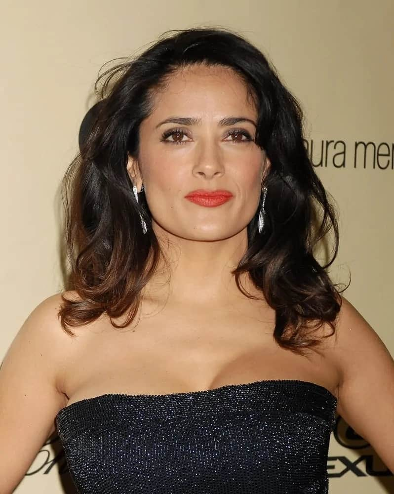 Salma Hayek was seen with her chic and fun loose waves to match her shiny black dress at the 2013 Weinstein Company Golden Globes After Party last January 13, 2013.
