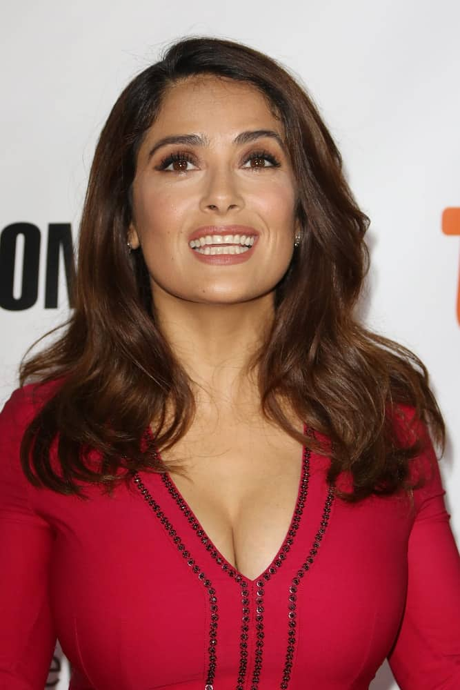 Actress Salma Hayek attended the 'Septembers Of Shiraz' premiere during the 2015 Toronto International Film Festival held at Roy Thomson Hall last September 15, 2015 in Toronto. She was a stand out in her red dress and flowing highlighted wavy hair.