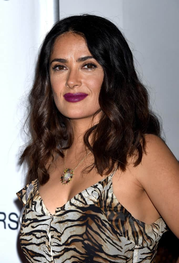 Salma Hayek wore an animal print dress and sexy tousled wavy hair at the Septembers of Shiraz Premiere last June 21, 2016 in Los Angeles.
