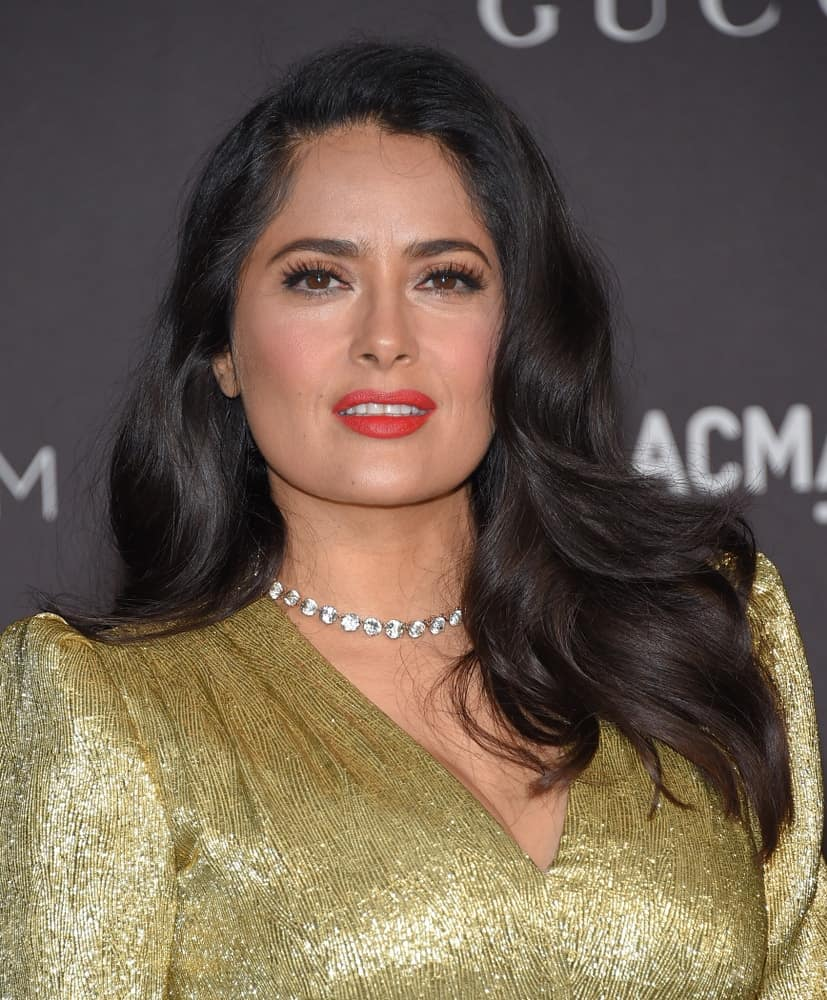 Salma Hayek attended the 2018 LACMA Art + Film Gala last November 3, 2018 in Hollywood. She was positively glowing in her golden outfit and side-parted wavy raven hair.