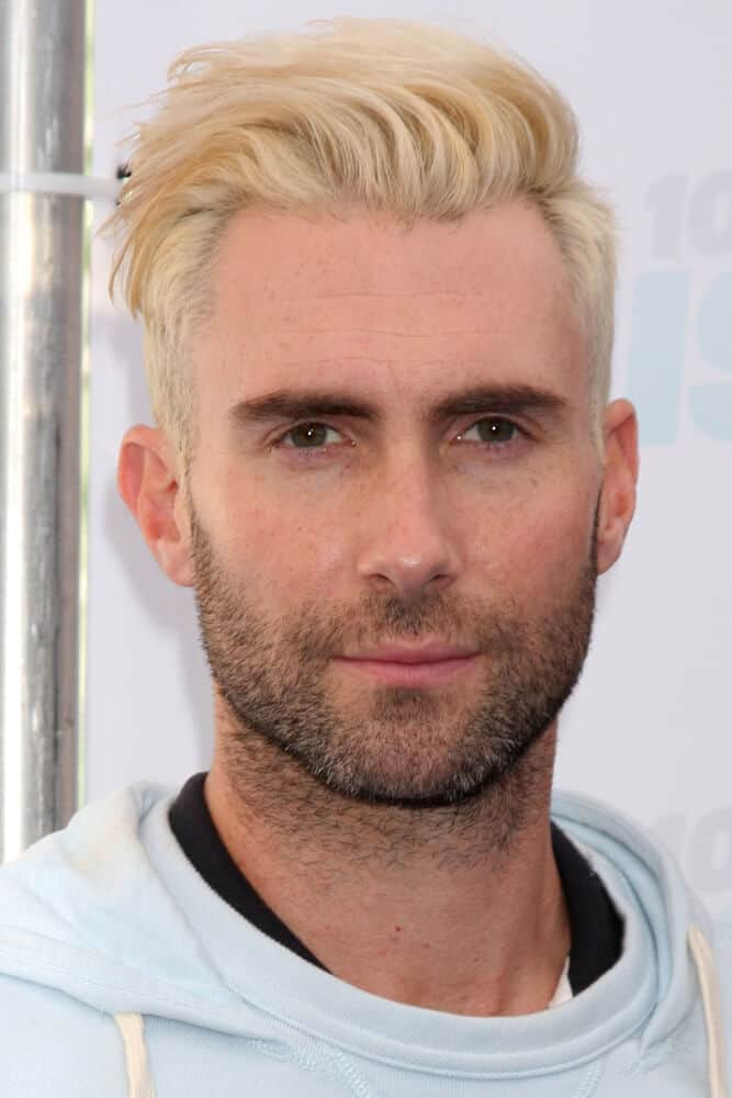 Adam Levine's versatile looks allow him to experiment on different hairstyles knowing that his facial features will surely adapt. The singer went blonde last 2014 which was first seen by the public via his Instagram post. This photo was taken during the 2014 Wango Tango.