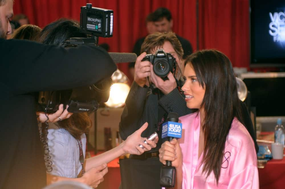 Adriana Lima was interviewed backstage during the 2010 Victoria's Secret Fashion Show on November 10, 2010 at the Lexington Armory in New York City. She was still in her pink robes and her layered straight hair had subtle highlights.