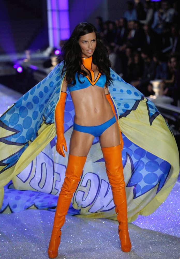 Model Adriana Lima walks the runway during the 2011 Superhero theme Victoria's Secret Fashion Show in New York City last November 9, 2011 where she strutted with her long dark wavy hair with pins to keep the top sleek.