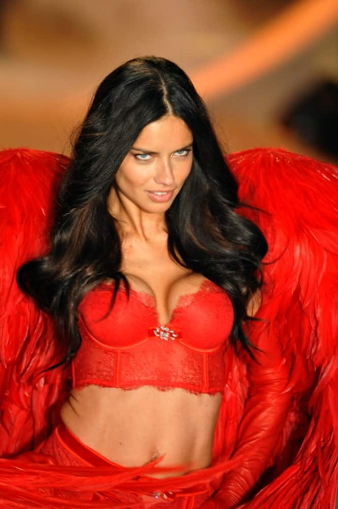 Adriana Lima walked the runway in this sexy red lingerie complemented by thick and wavy long dark hair with reddish brown highlights at the 2013 Victoria's Secret Fashion Show last November 13, 2013 in New York City.