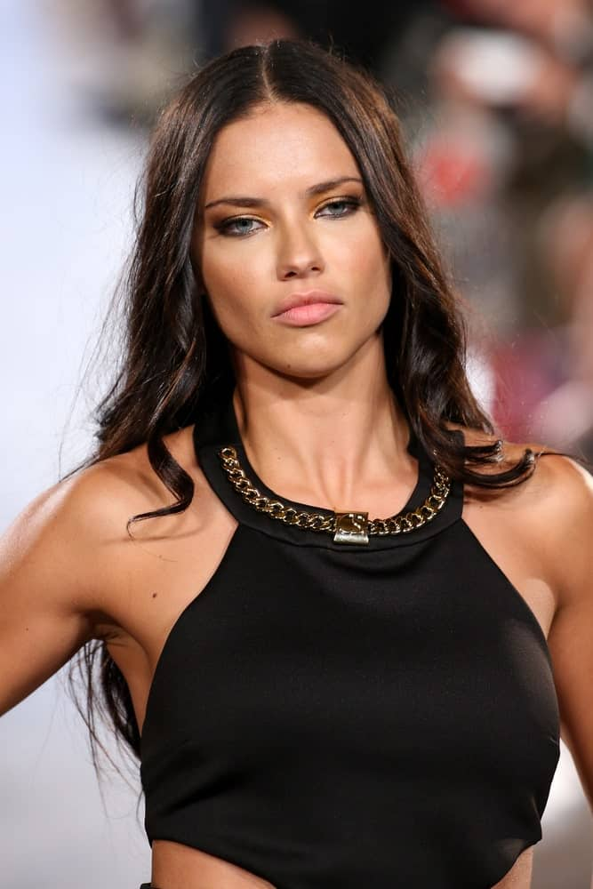 Model Adriana Lima had a center-parted long tousled  wavy hair when she walked the Carmen Steffens runway at the Grand Central Terminal, on September 13, 2015 in New York.