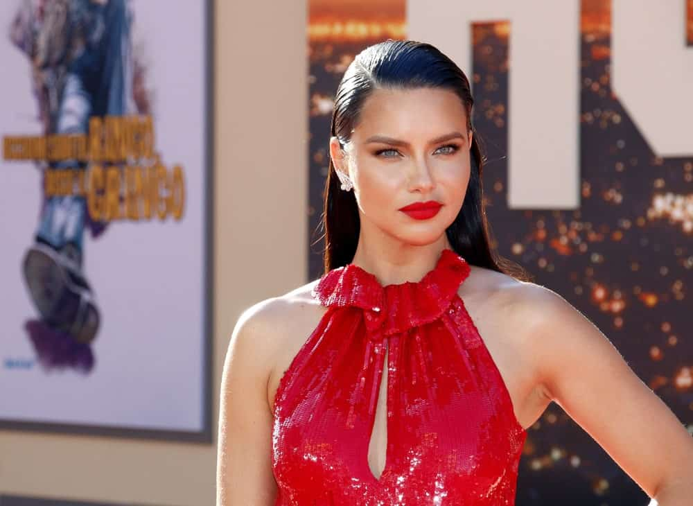 Adriana Lima was at the Los Angeles premiere of 'Once Upon a Time In Hollywood' held at the TCL Chinese Theatre IMAX in Hollywood last July 22, 2019 with a stunning red dress and a dark long straight hair slicked back.