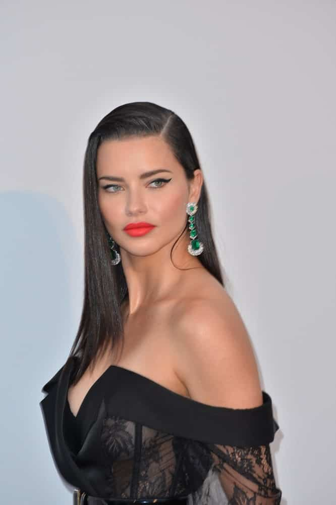 May 23, 2019 was when Adriana Lima attended the amfAR's Gala Cannes event at the Hotel du Cap d'Antibes with long side-parted black hair to complement her black sheer dress.