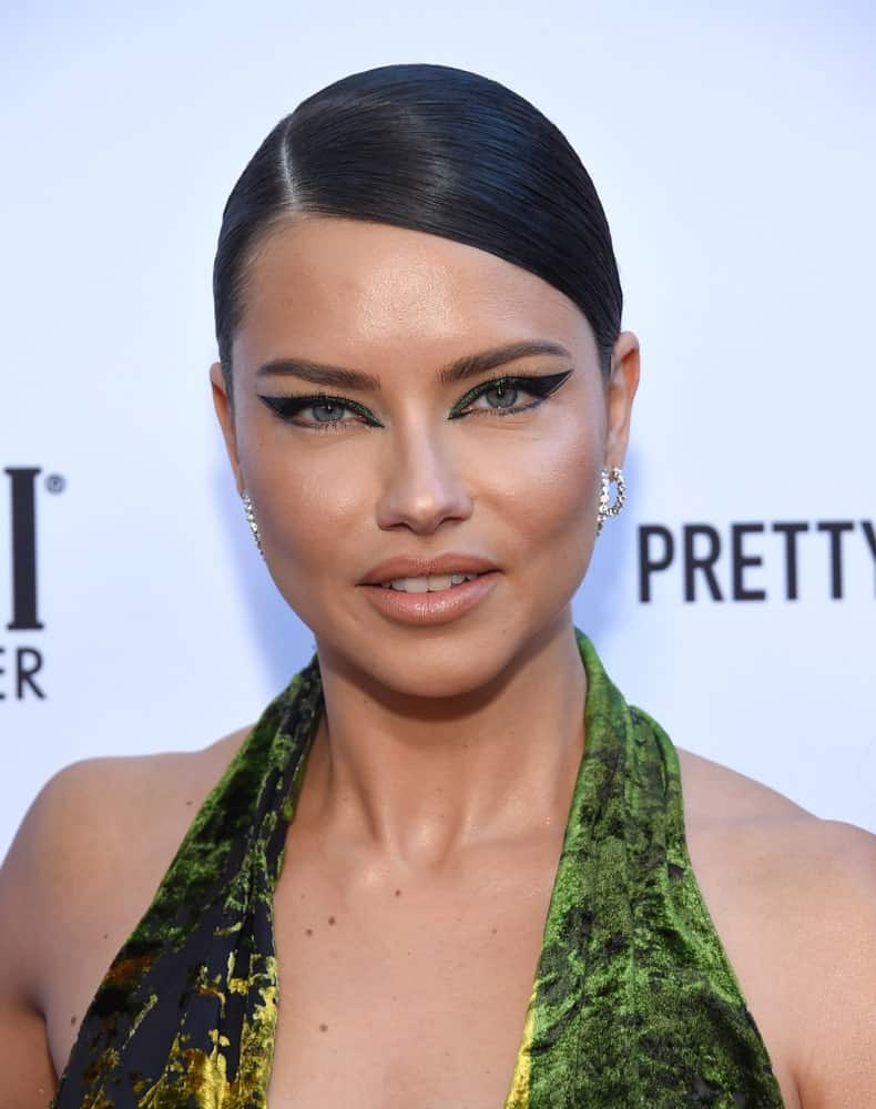 Adriana Lima arrived for the The Daily Front Row 5th Annual Fashion LA Awards on March 17, 2019 in Beverly Hills. She was a stand-out with her green confident dress and beautiful make up to complement her simple bun updo.