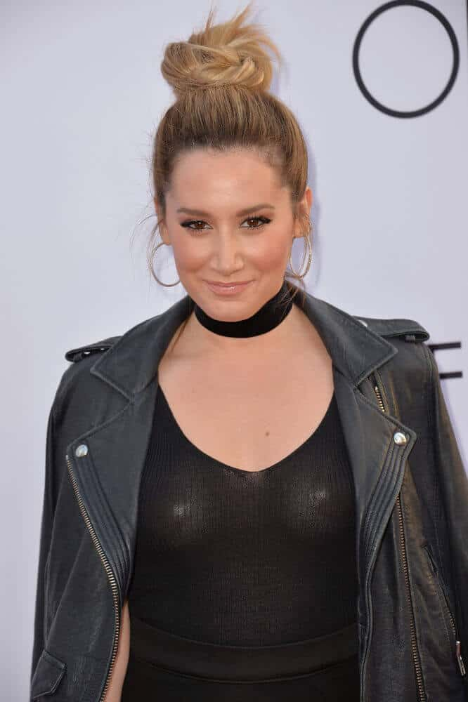 "Here is Ashley Tisdale sporting a chunky, high bun at the world premiere of ""Mother's Day"", April 13, 2016."