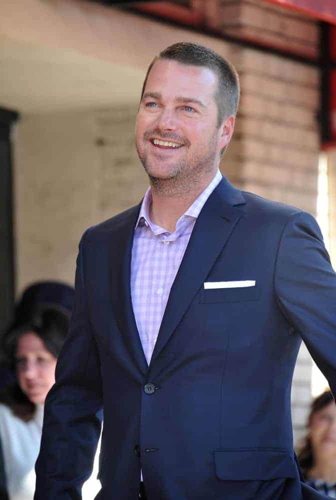 On March 5, 2015, actor Chris O'Donnell was at the Hollywood Boulevard where he was honored with the 2,544th star on the Walk of Fame. He wore a navy blue jacket over his button-down shirt and topped it with a dark brown short crew cut with a slight fade on the sides.