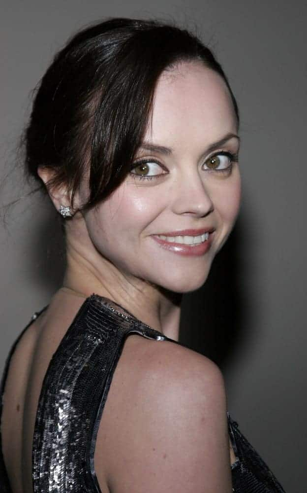 Christina Ricci was at the Rodeo Drive Walk Of Style Award honoring Gianni and Donatella Versace held at the Beverly Hills City Hall in Beverly Hills on February 8, 2007. She wore an elegant dress with her raven bun hairstyle that has long side-swept bangs.