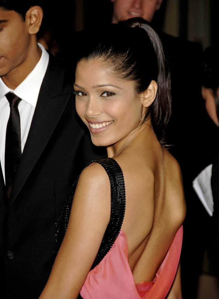Freida Pinto's smile was contagious with her Jean Paul Gaultier pink dress and simple high ponytail at the LAFCA 34th Annual Los Angeles Film Critics Awards in Los Angeles, January 12, 2009.