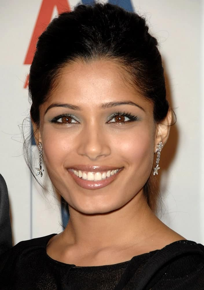 Freida Pinto's thick black hair was styled into this semi-messy updo for the 2009 BAFTA/LA Britannia Awards, Hyatt Regency Century Plaza in Los Angeles last November 5, 2009.