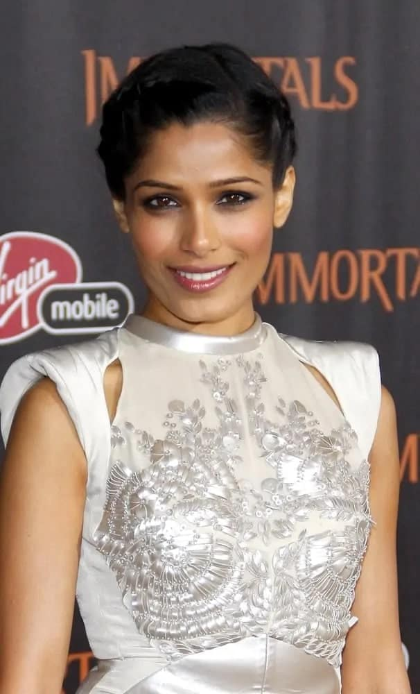 Freida Pinto wore her gorgeous raven hair styled in an elegant french braid updo contrasting her brilliant pearly white outfit at the World premiere of