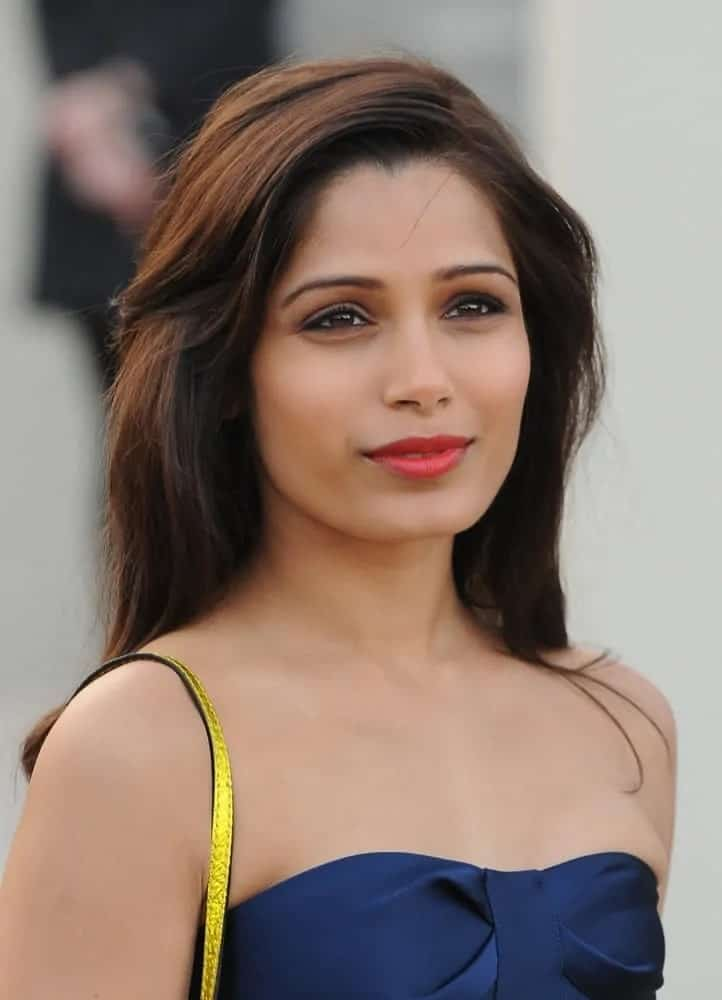 The Indian beauty looked fresh and gorgeous with her loose medium-length tousled hairstyle and blue strapless outfit at the Burberry Prorsum show during London Fashion Week on February 18, 2013.