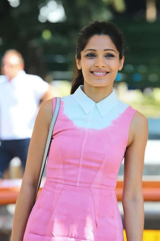 Freida Pinto pulled off a prim and proper look with her simple ponytail and pink summer outfit at the Miu Miu Women's Tales Talks during the 70th Venice Film Festival, August 31, 2013.