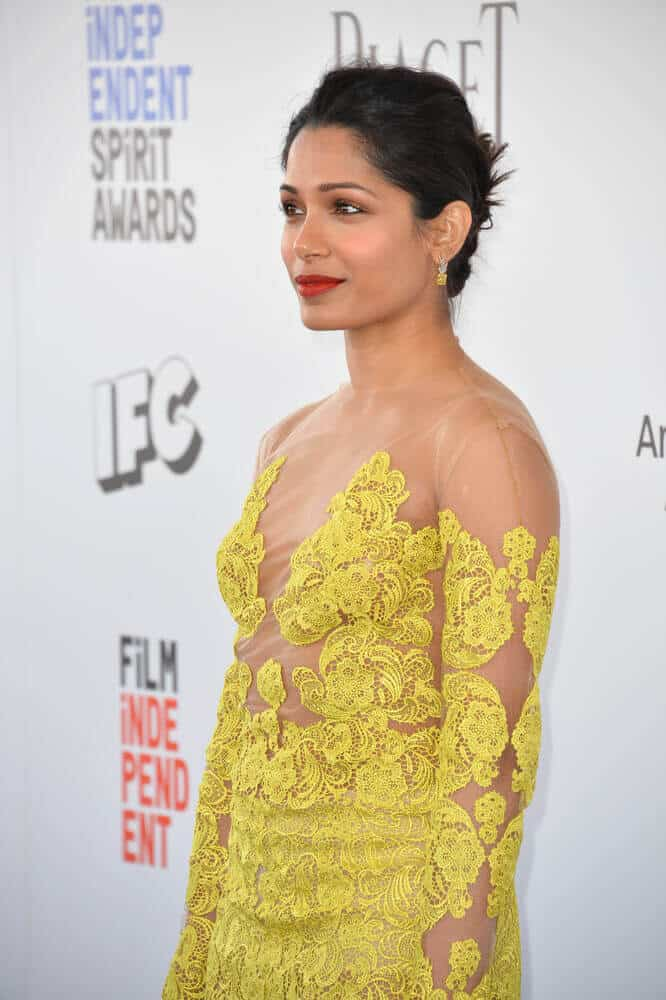 Pinto's elegant-looking yellow gown was worn with a simple upstyle during the 2017 Film Independent Spirit Awards.