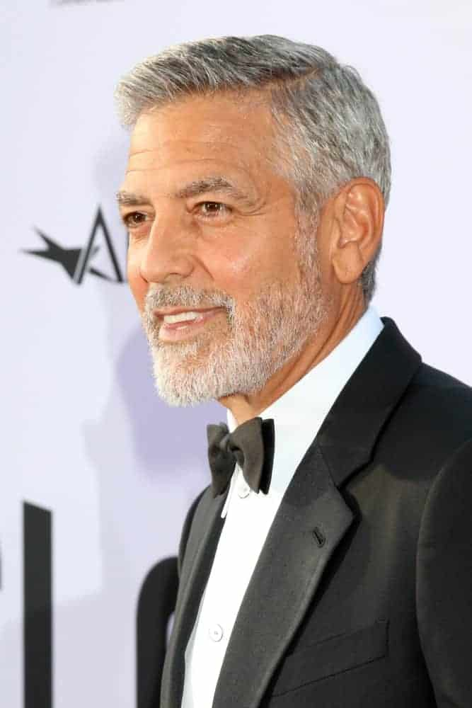George Clooney attended the American Film Institute Lifetime Achievement Award to him at the Dolby Theater on June 7, 2018 in Los Angeles, CA. He came wearing a classic tux with his gray side-parted fade hairstyle.