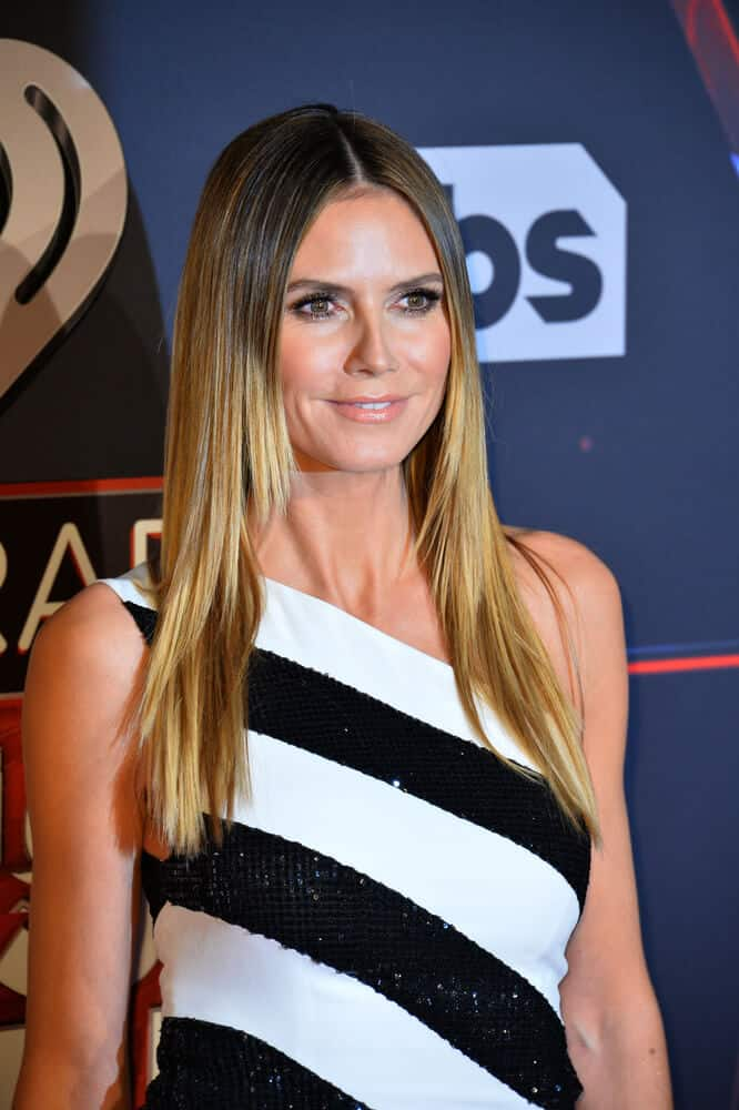 During the 2017 iHeartRadio Music Awards, the actress exhibited a simply straightened, center-parted hairstyle. She also has sublte layers and darker roots that made her thin hair, appear fuller than usual.