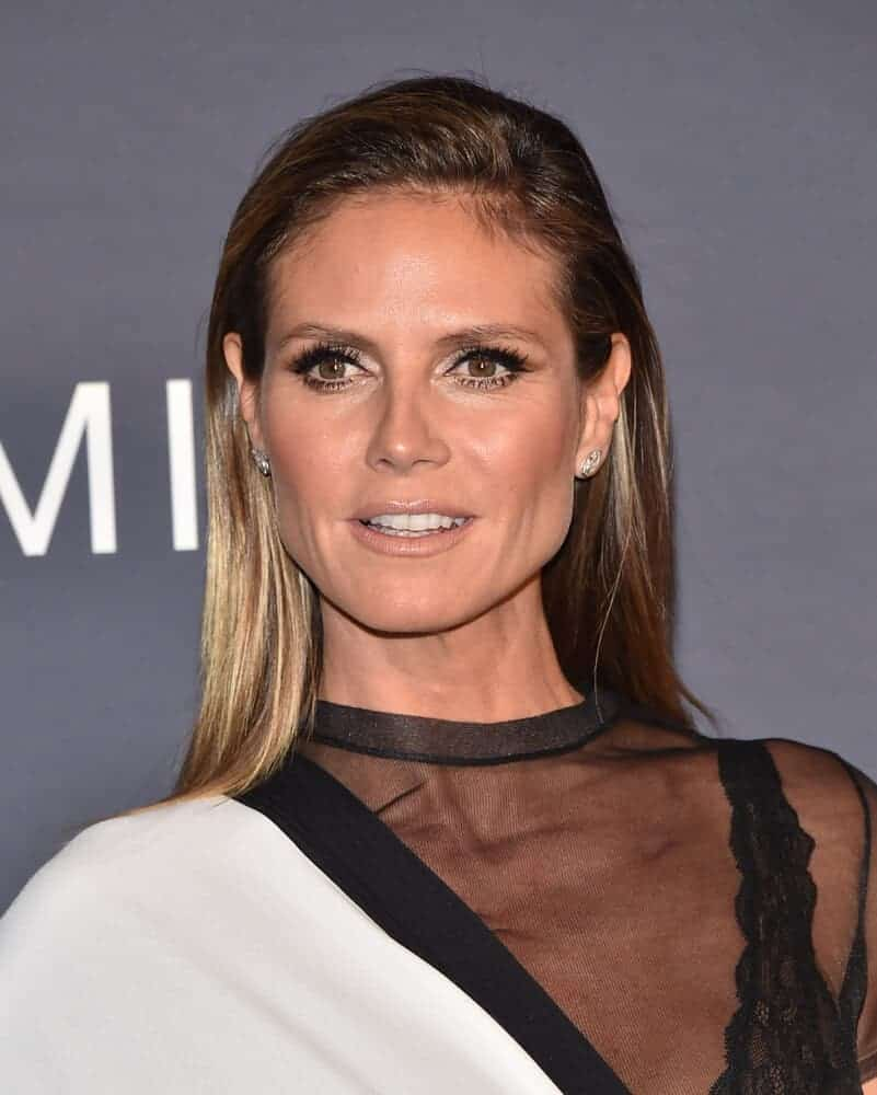 Heidi Klum upgraded her usual blonde look by going brunette during the InStyle Awards last October 23, 2017. With her straight and dark-colored hair flaunted, a different kind of aura was felt.